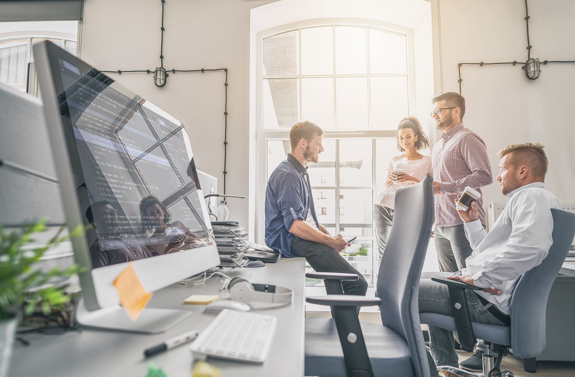 Web design team discussing a clients content